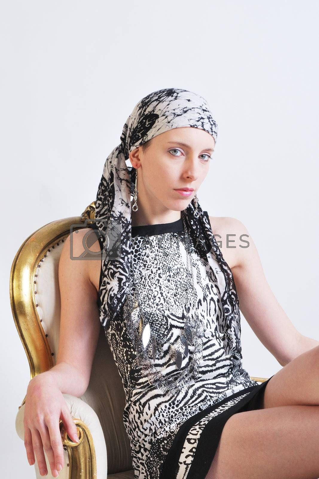 Woman in black and white dress and head scarf