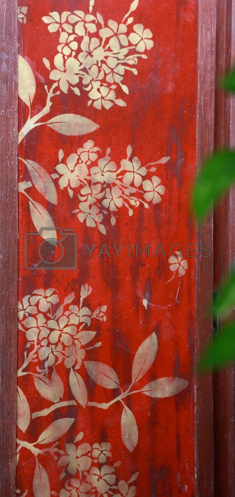 Wall painted with traditional Thai decorations.