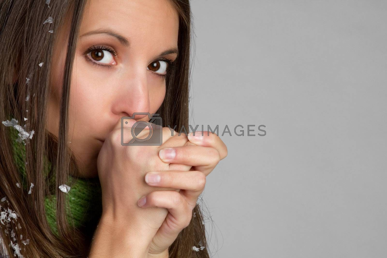 Cold woman blowing on hands