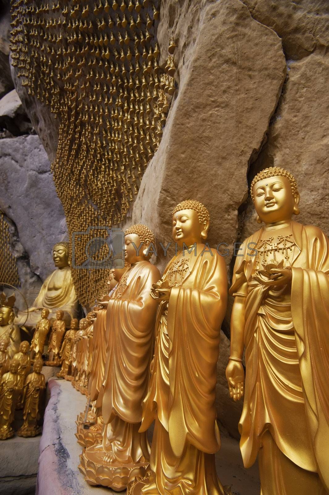 Golden statues of Buddha in carving in Ipoh, Malaysia, Asia.