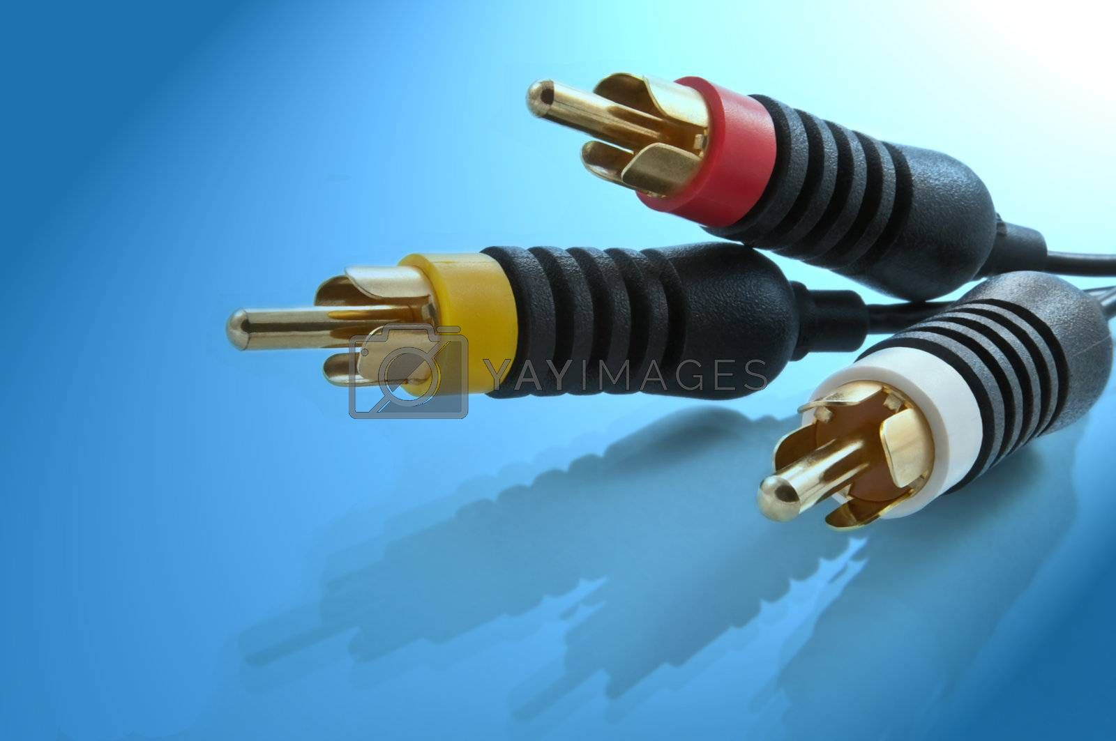 Close up of AV cable connectors with blue light effect background.