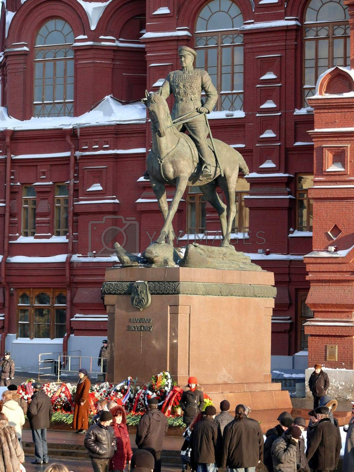 Moscow, Russia - February 23, 2010: Winter day. Peoples walks near monument of Marshal Zhukov in Moscow, Russia