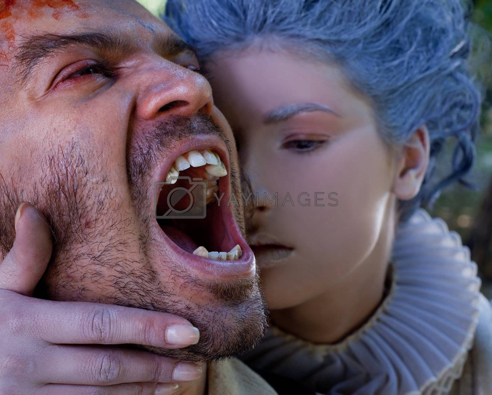 Close-up of medieval woman embracing wounded male vampire