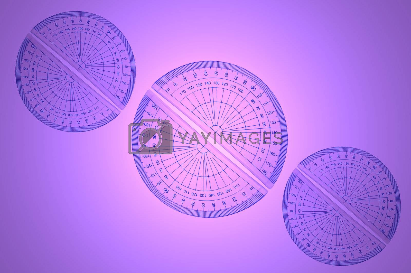 Several blue plastic protractors arranged in formation over a pink and violet light effect background.