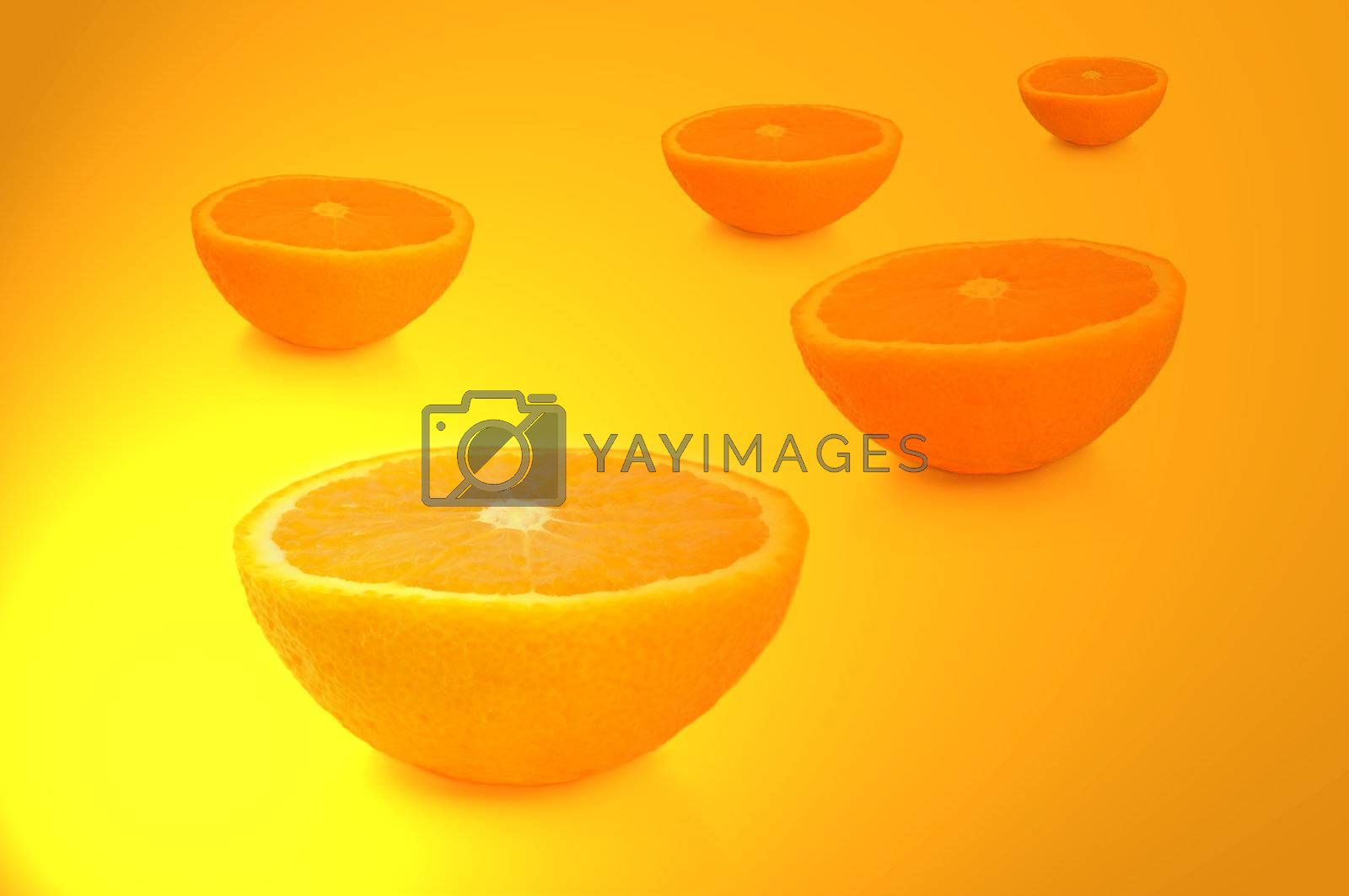 FIve freshly cut orange halves arranged over vibrant yellow and gold light effect.