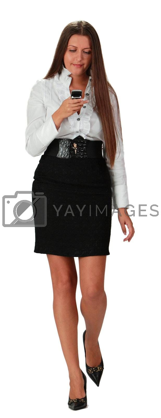 Image of a young businesswoman checking her mobile phone while is walking,isolated against a white background.