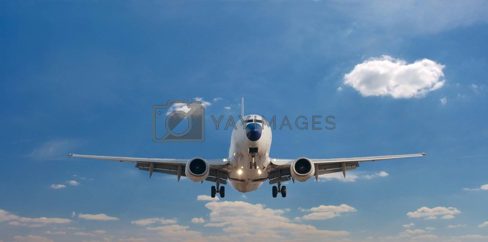 Airplane landing against clear blue sky