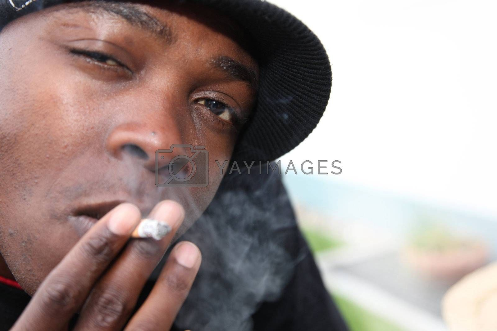 Portrait of a young African-Americans with cigarette