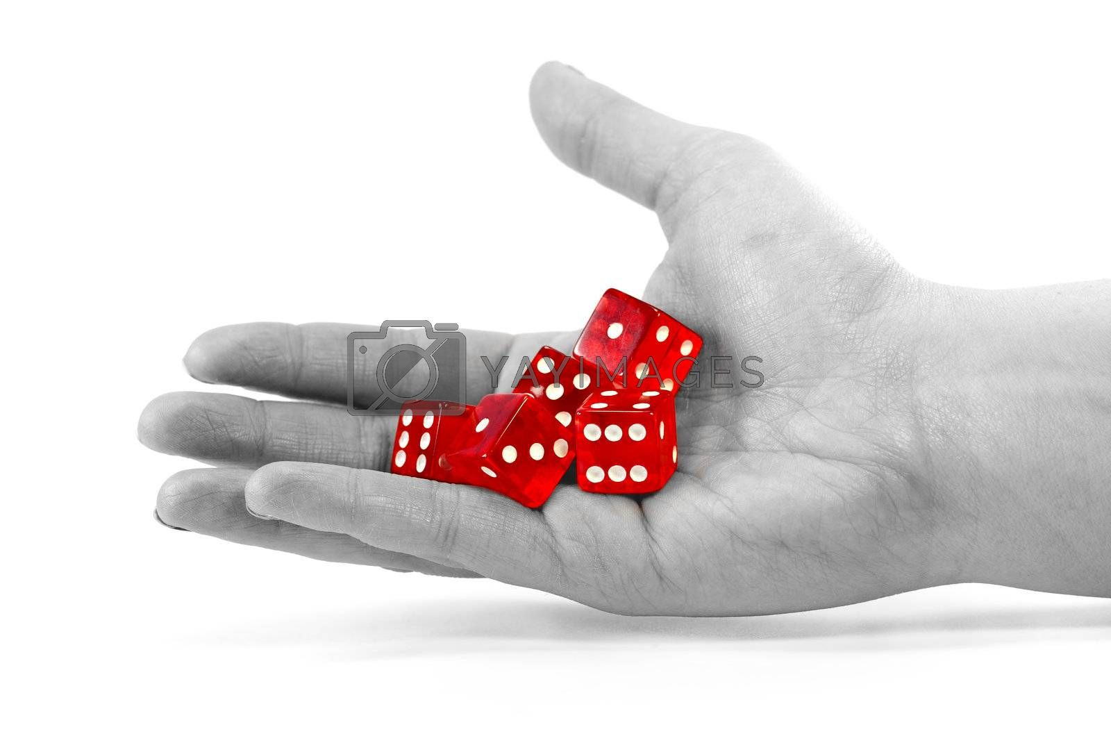 Red dices in a desturated hand