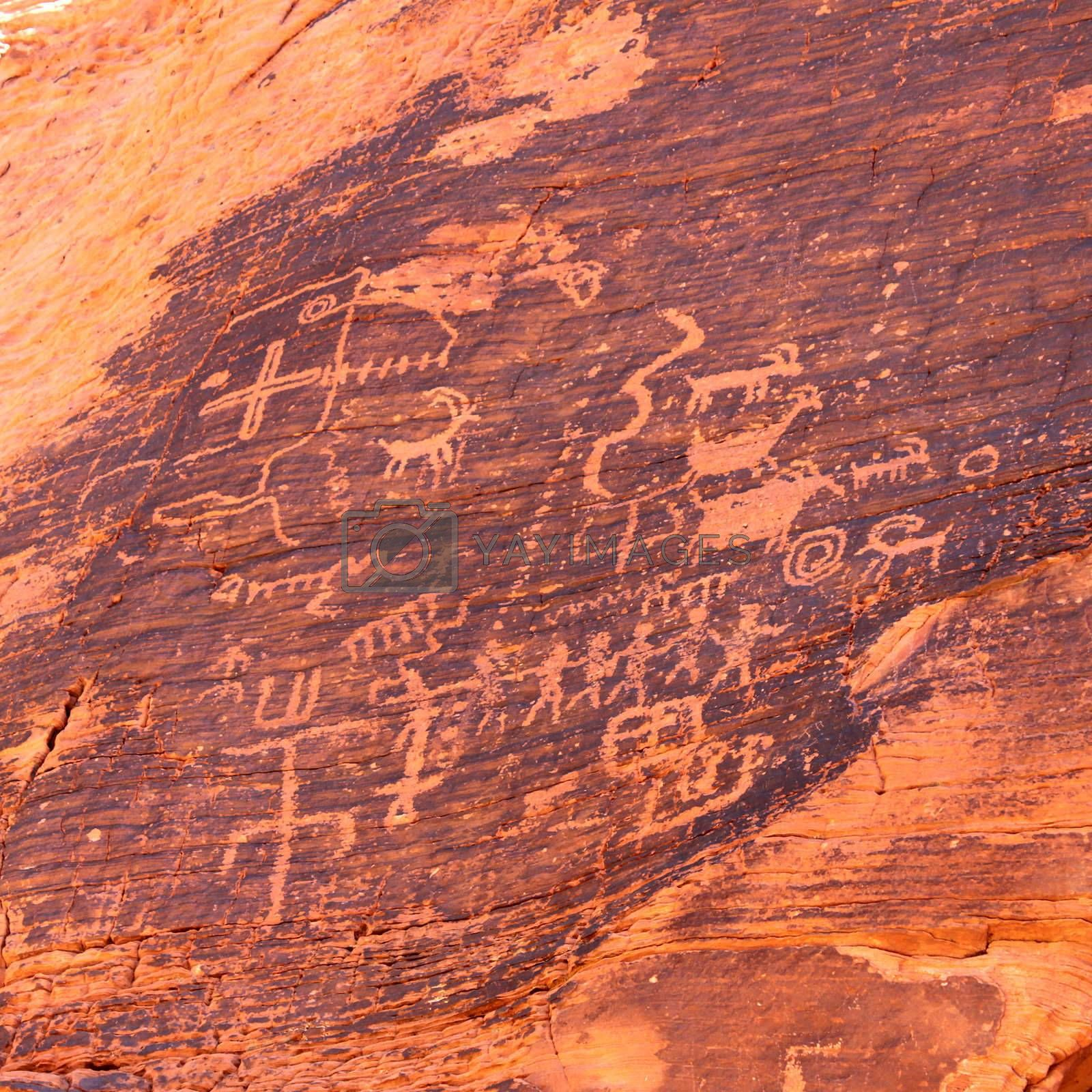 Strange petroglyphs on a rock wall at Valley of Fire State Park in Nevada.