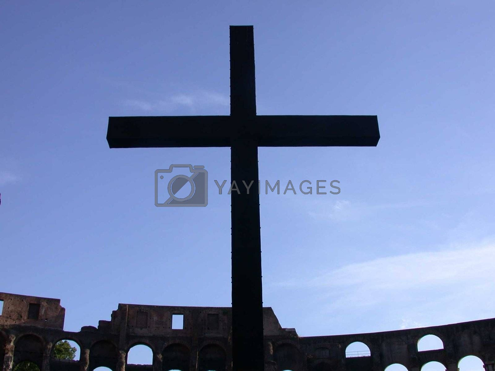 Cross at the colosseum in Rome Italy