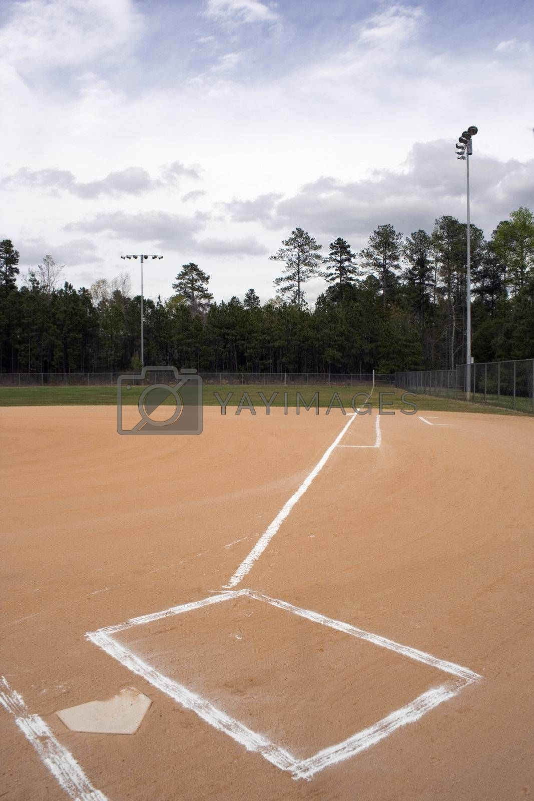 A view down the first base line on a baseball field.