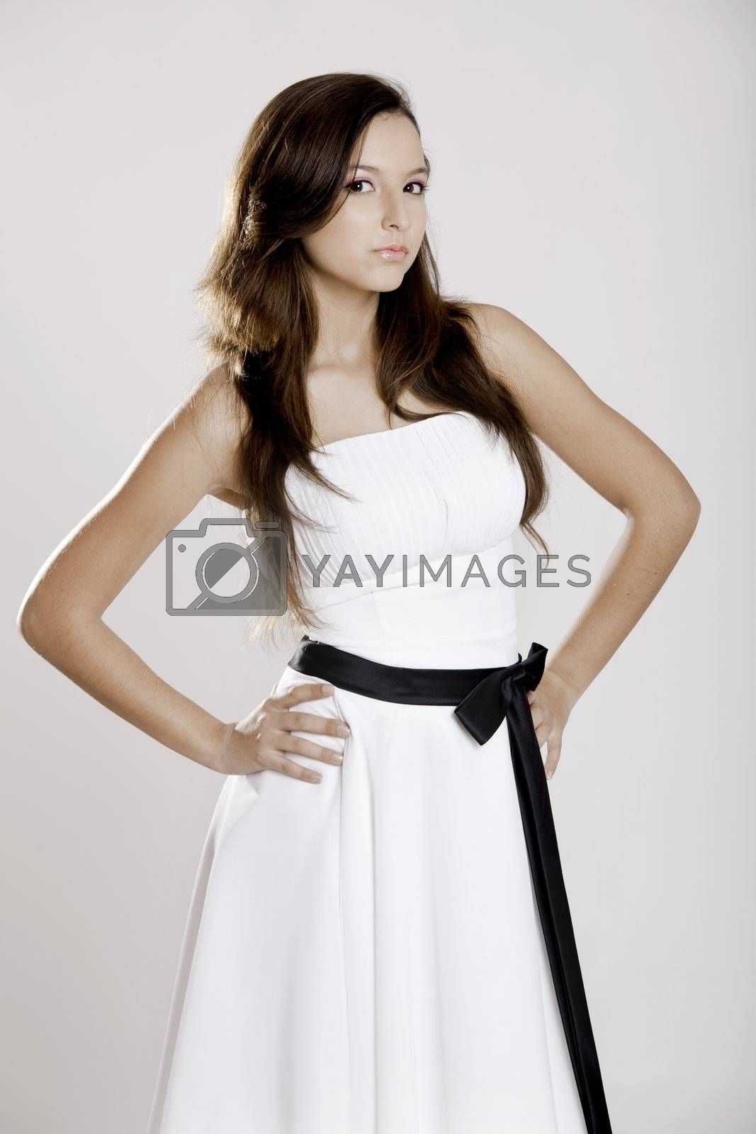 Beautiful and sexy woman wearing a wonderful white dress