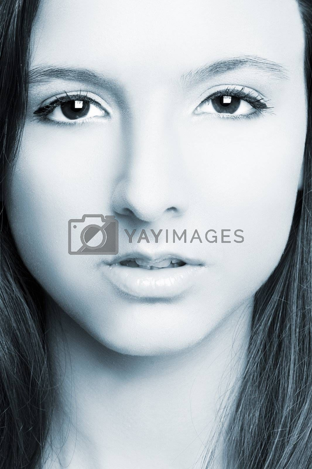 Close-up of beautiful woman face with perfect makeup, blue toned on PS