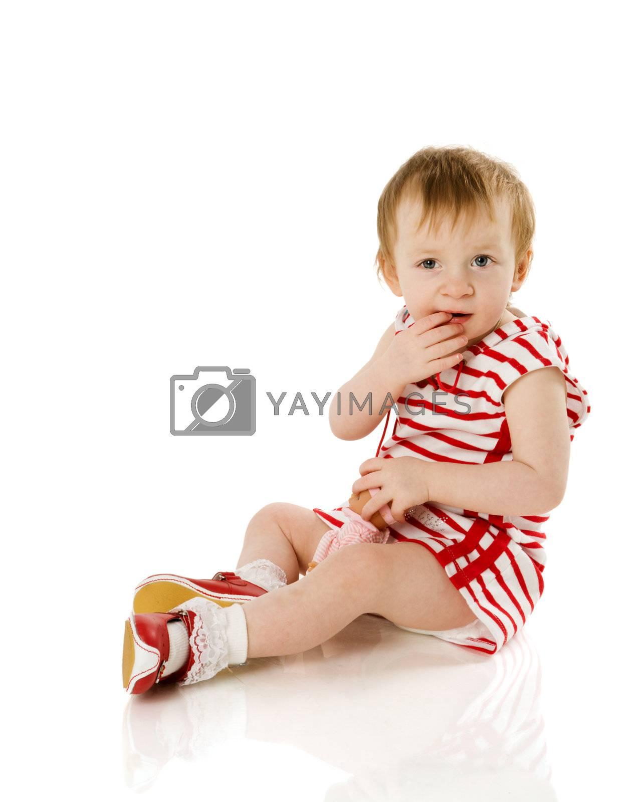 Toddler girl sitting on floor isolated on white
