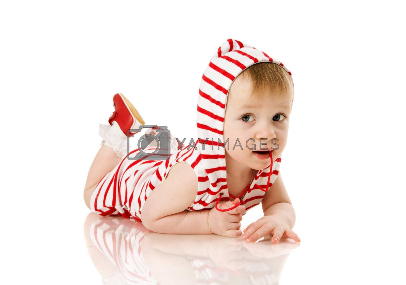 Toddler girl lying on floor isolated on white