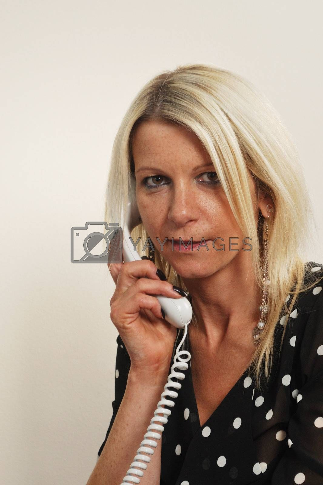 Blonde Businesswoman on phone listening