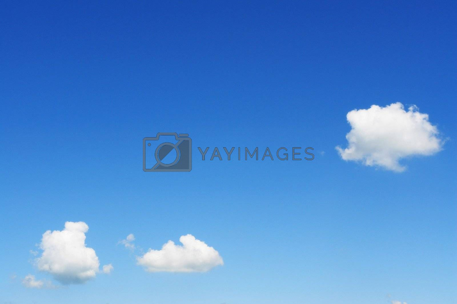 clouds in the sky drifting away in a light breeze