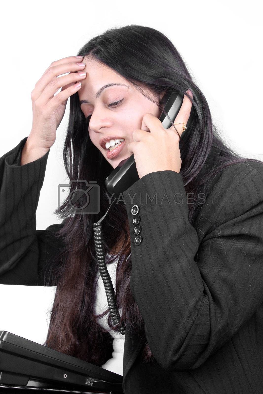 An Indian businesswoman facing problem in communicating with a client over a telephonic conversation.