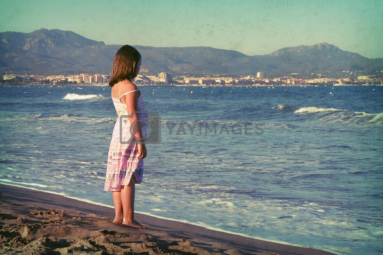 the little girl standing on the beach