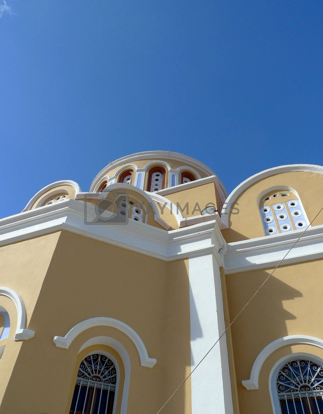 view of a bright greek cathedral from below