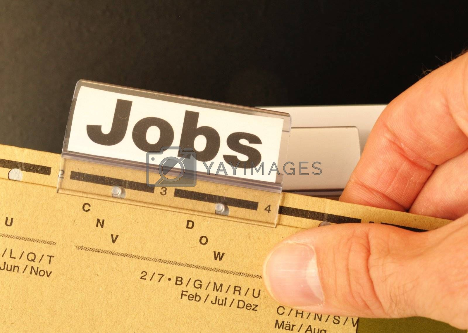 jobs or job concept with business folder in office showing earnings concept