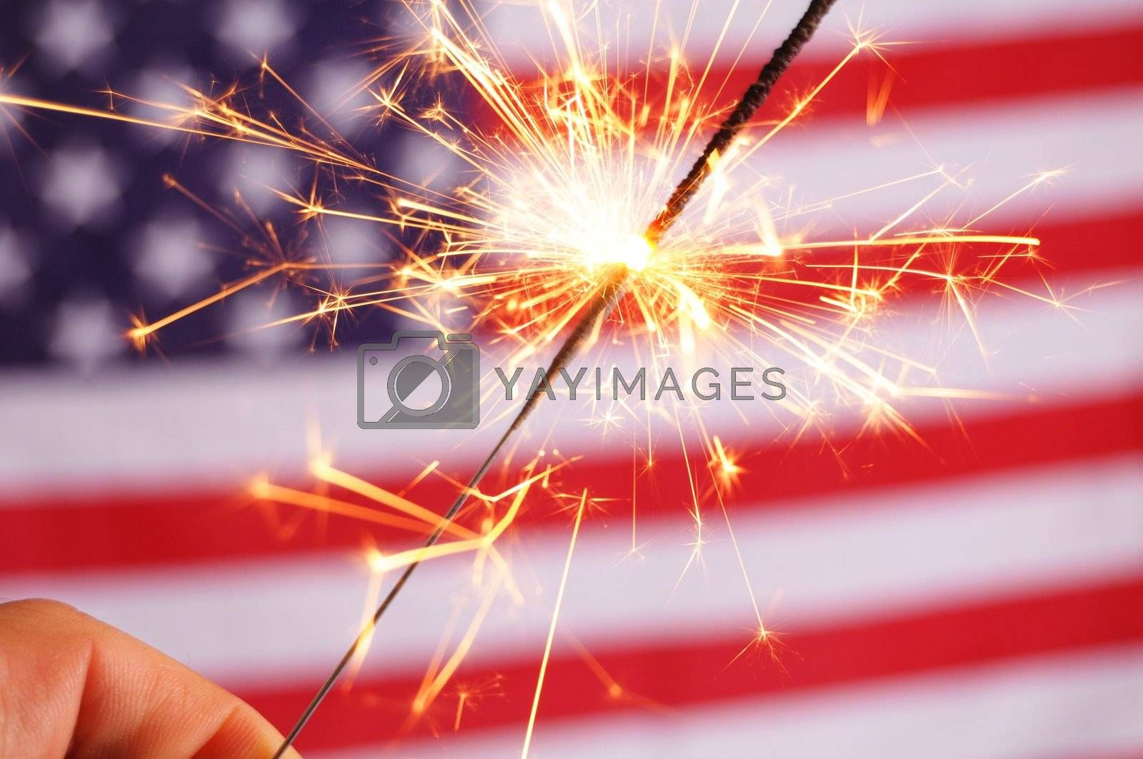 sparkler and usa flag showing 4th of july