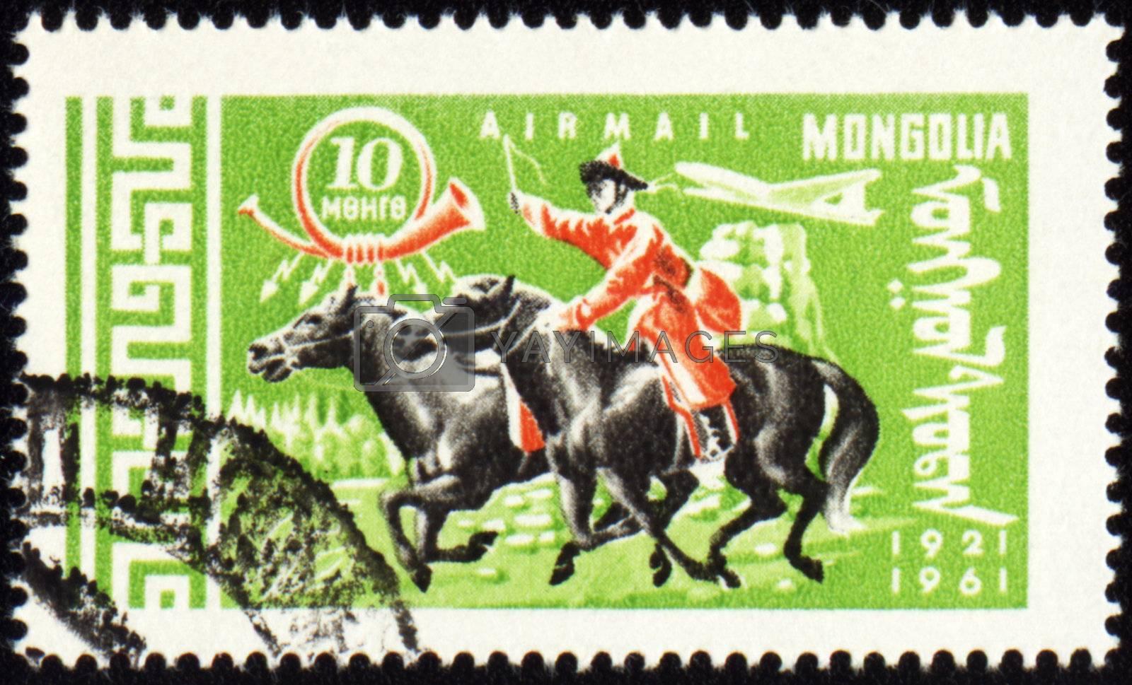 MONGOLIA - CIRCA 1961: stamp printed in Mongolia, shows Mongolian rider on horse, series, circa 1961