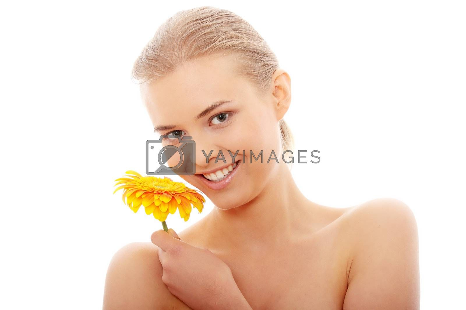 Portrait of the attractive girl without a make-up, with flower in hand, isolated on white background
