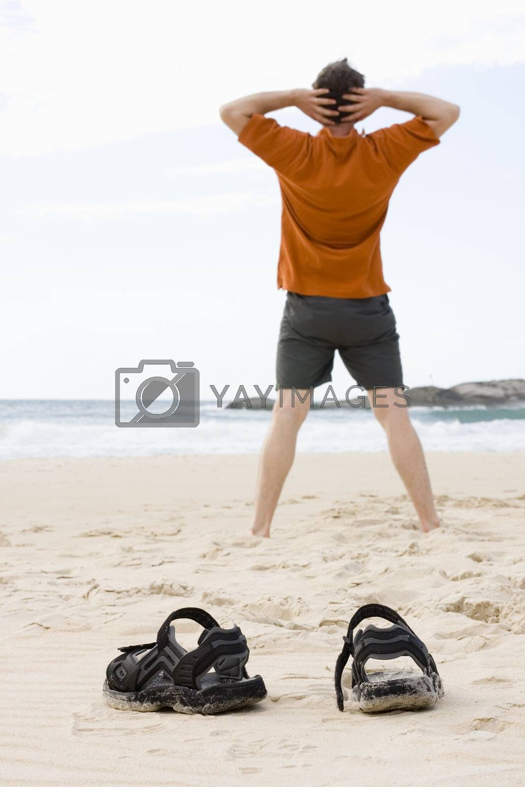 Man doing exercises on a beach in summer
