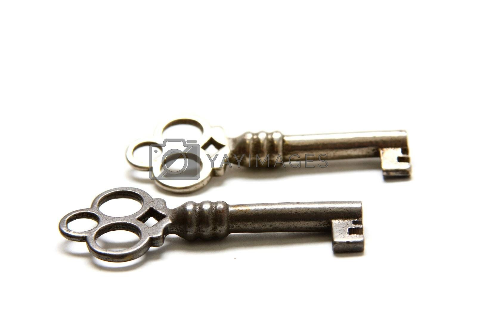 Isolated shot of two metal antique keys on white background