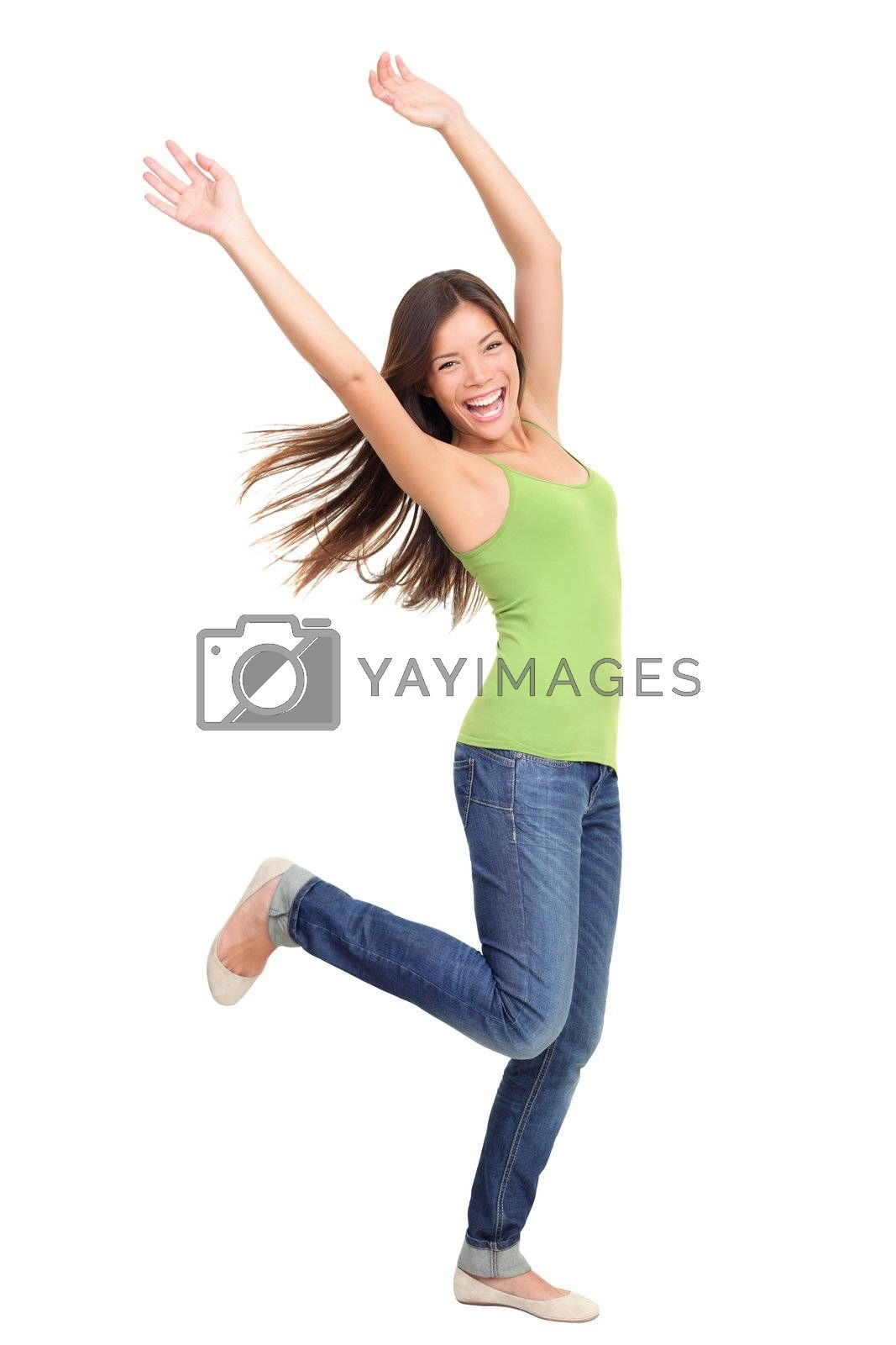 Success woman dancing and celebrating standing in full length isolated on white background. Natural beauty having fun. Mixed-race Asian Chinese / white Caucasian female model.