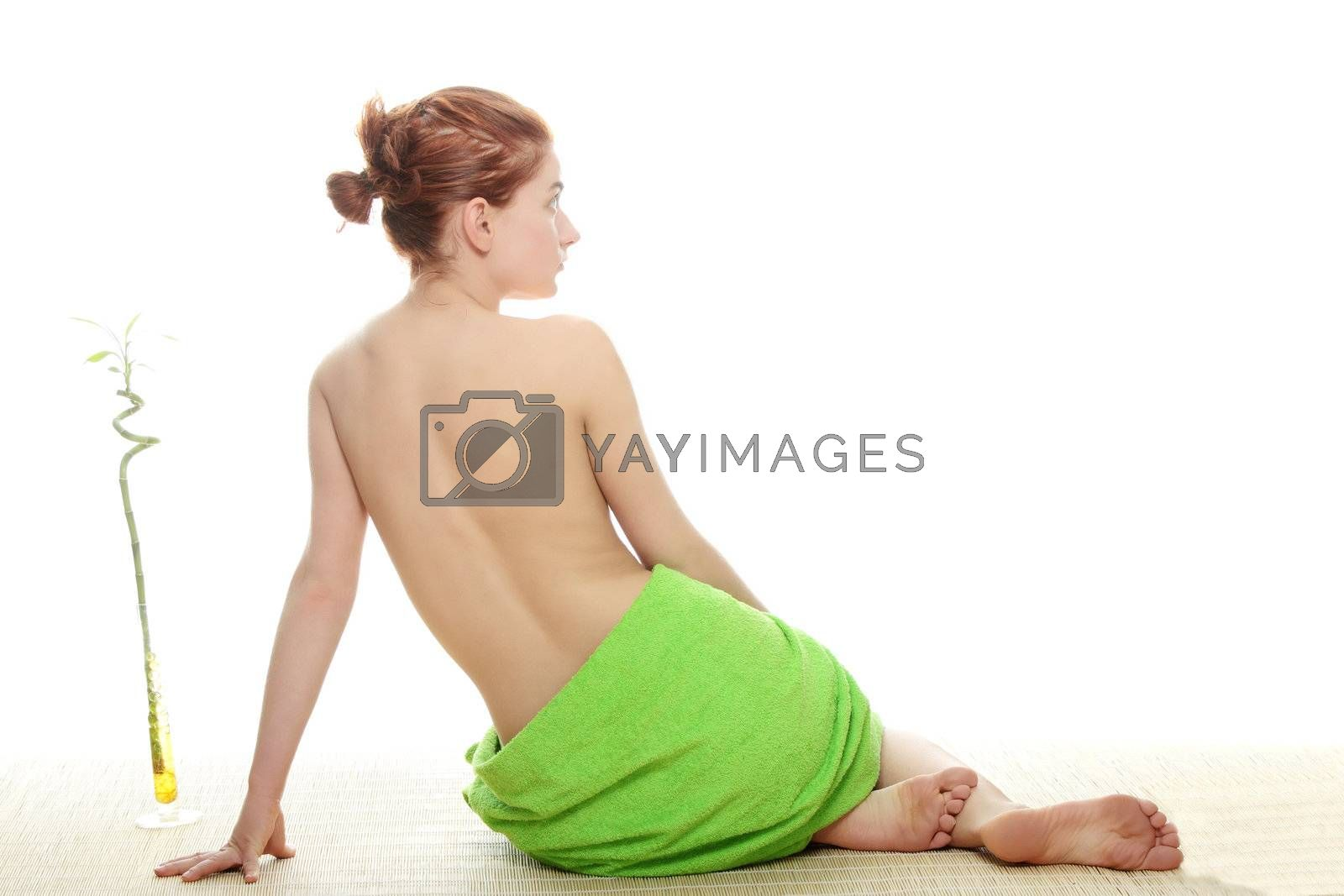 Portrait of beautiful woman before spa treatment. Isolated