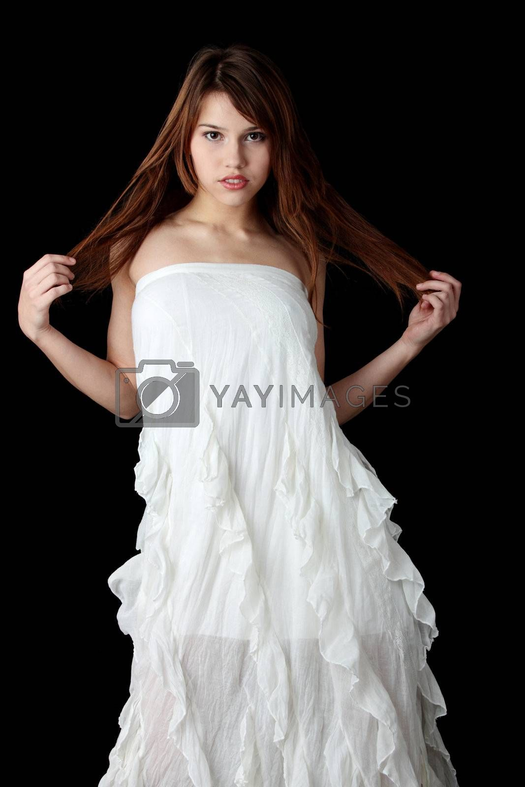 A young beautiful woman in white dress