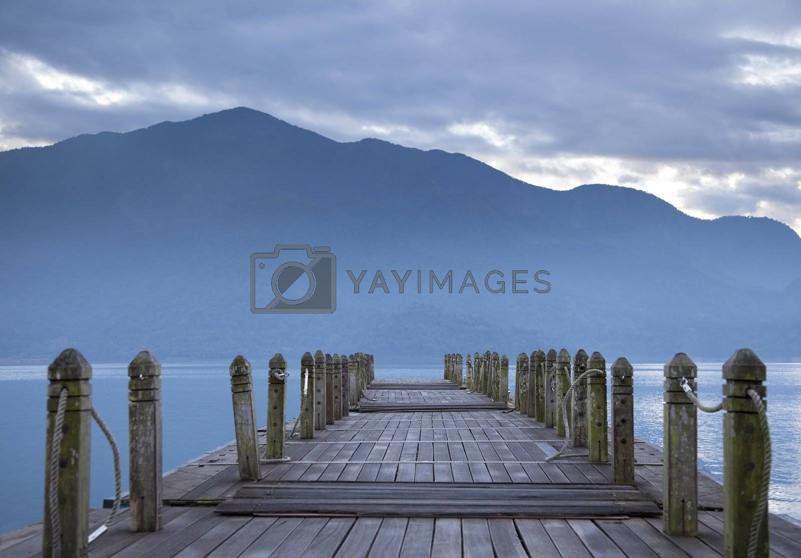 Royalty free image of look on pier and mountain in the morning by tomwang