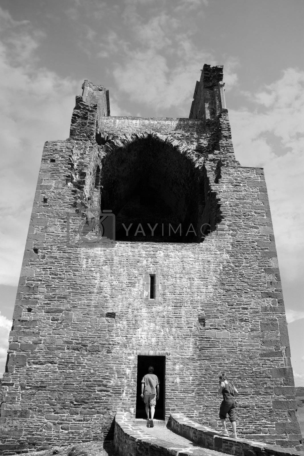 Ruins of a five-storeyed rectangular towerhouse within a bawn Partly destroyed in the 17th century in Ballylongford county kerry ireland in black and white