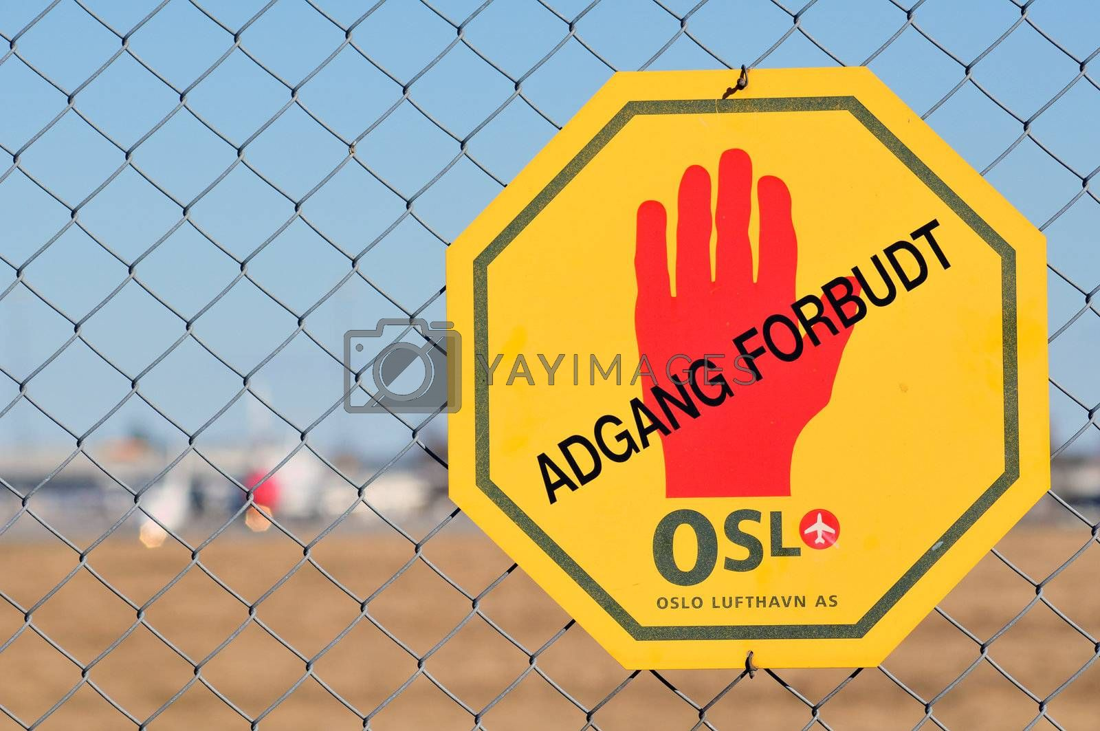 Warning sign at fence round Gardermoen airport Oslo Norway