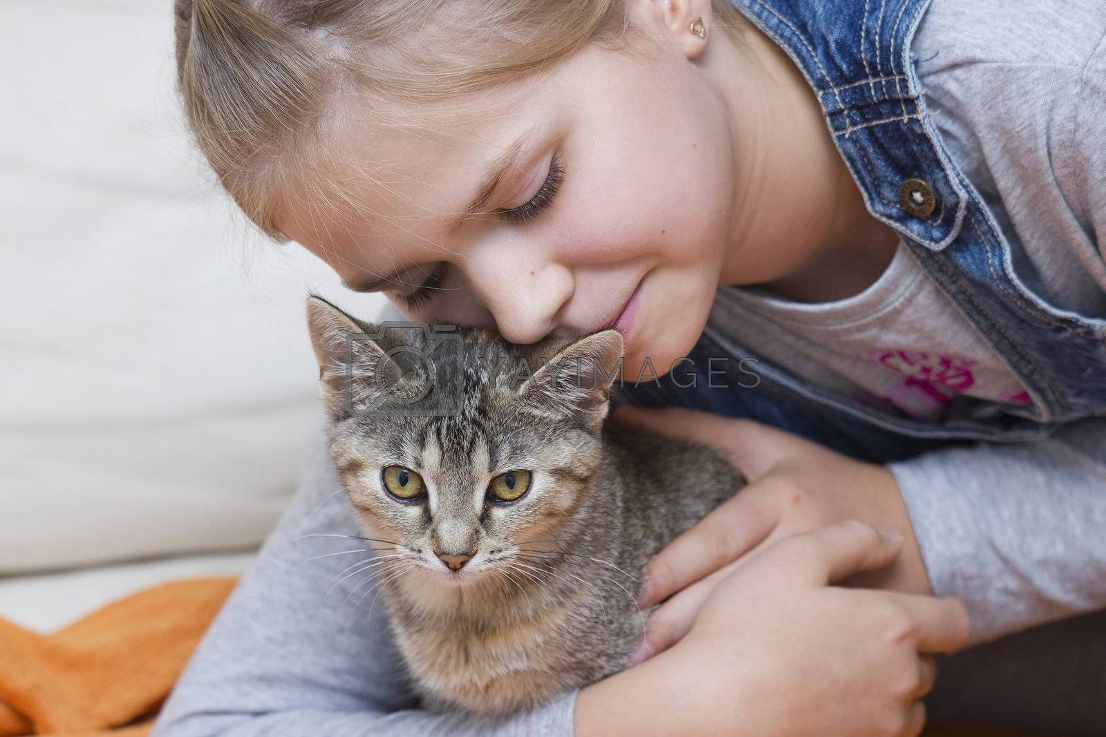 portrait of child with kitten