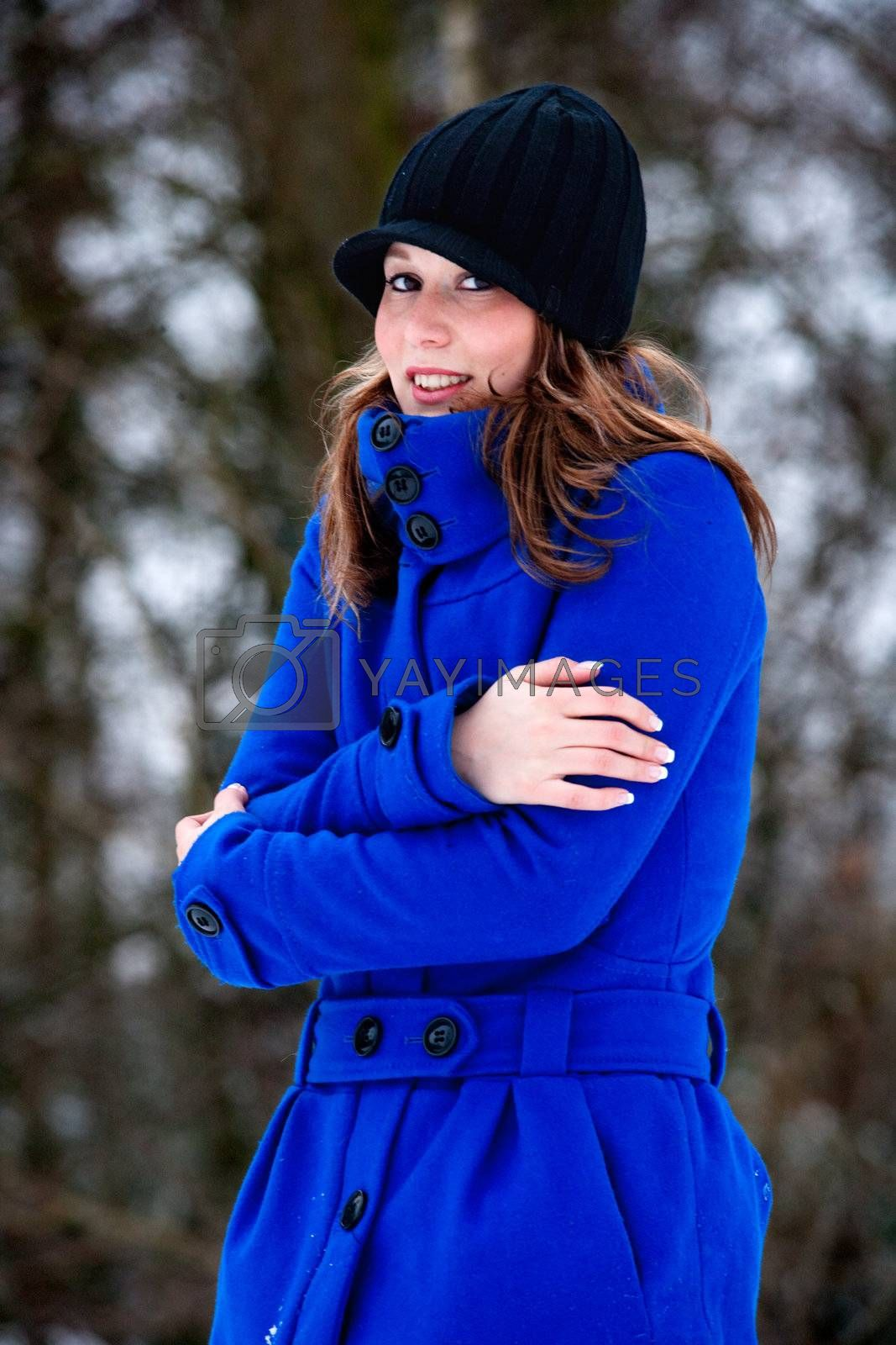 freezing cold girl in blue winter coat