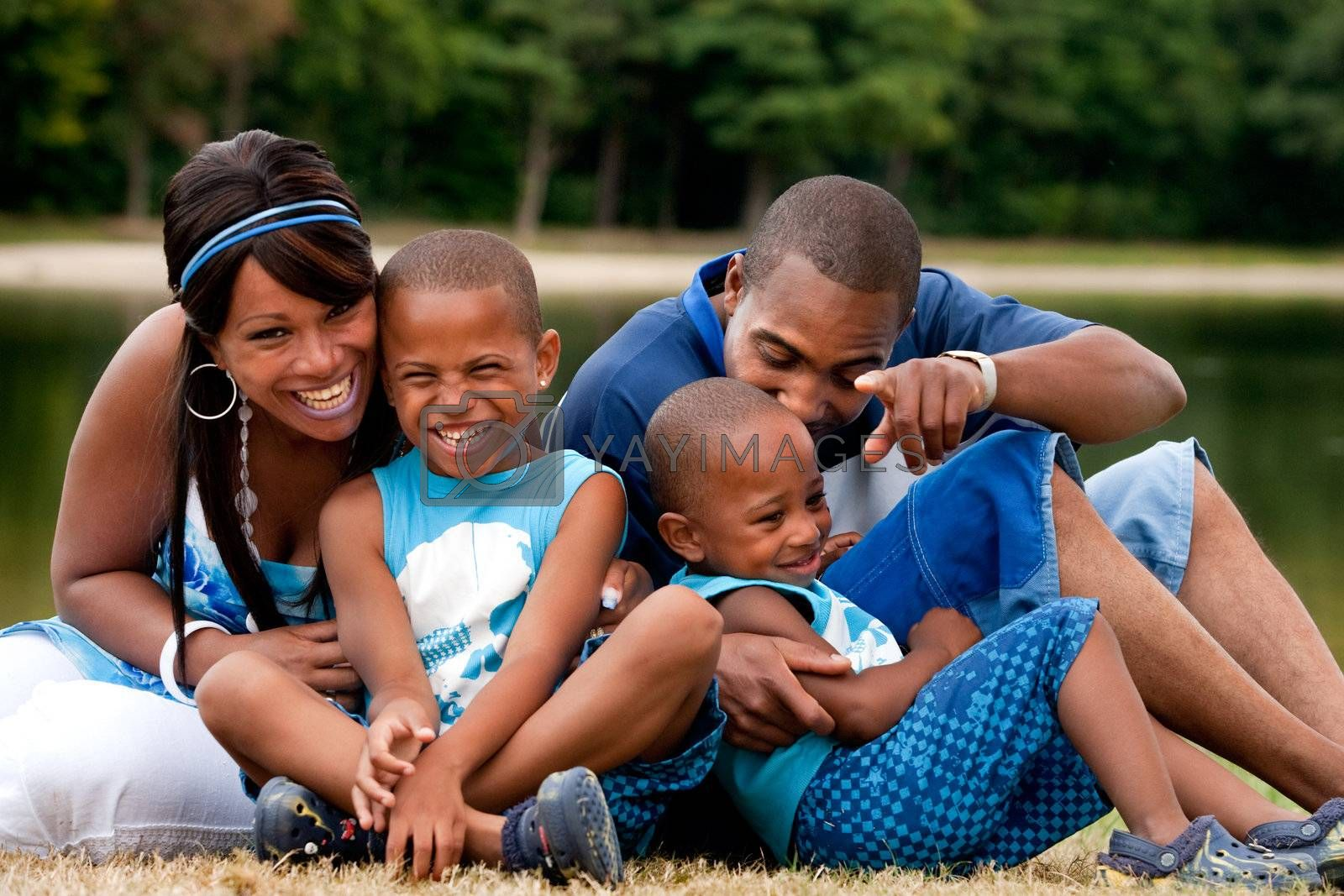 Happy black family enjoying their free day