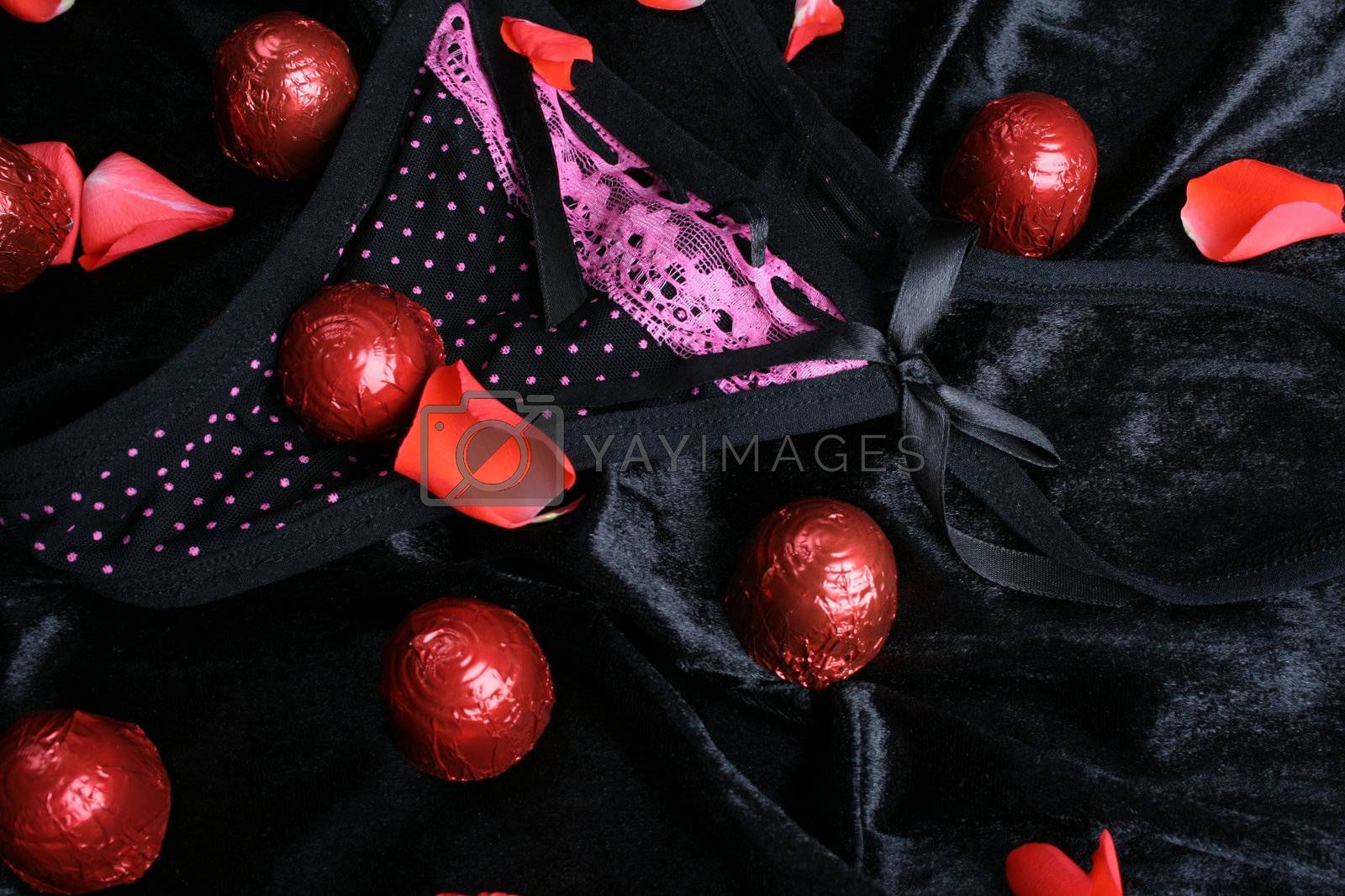 Lace polkadot underwear and chocolates with rose petals