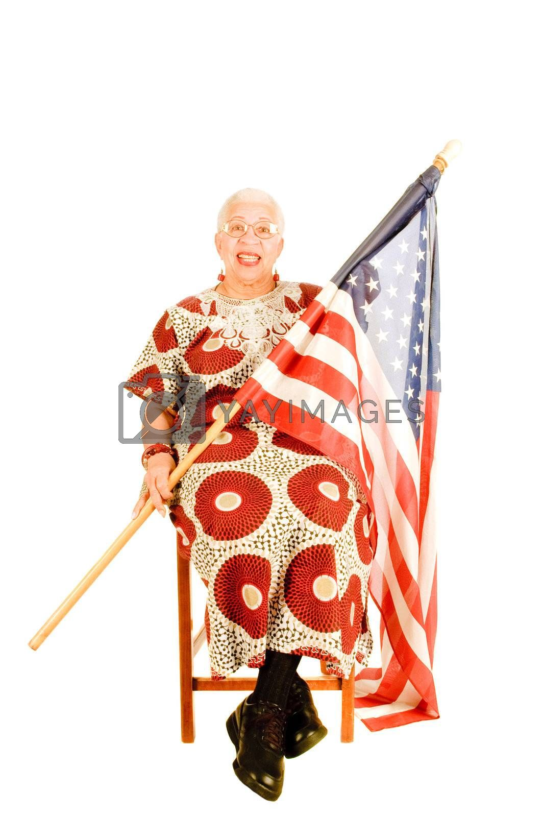 elderly patriot sitting with flag draped across her for a labor day or 4th of July celebration, isoalted on white