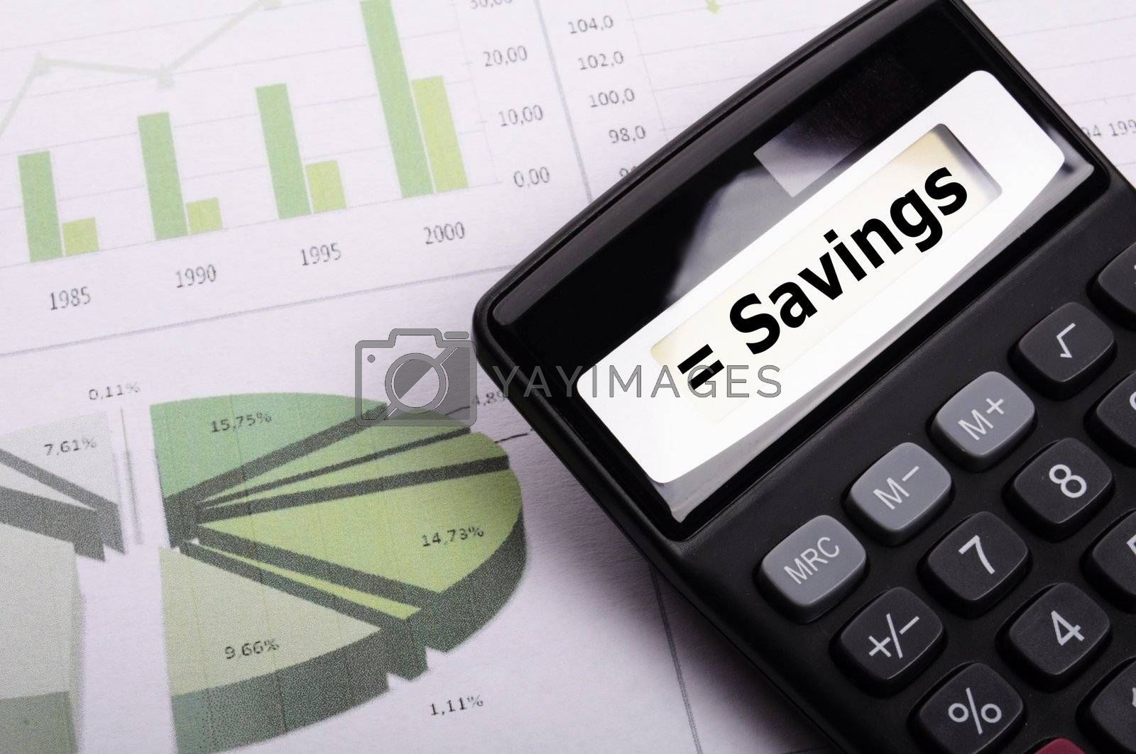 save money concpet with word savings on calculator