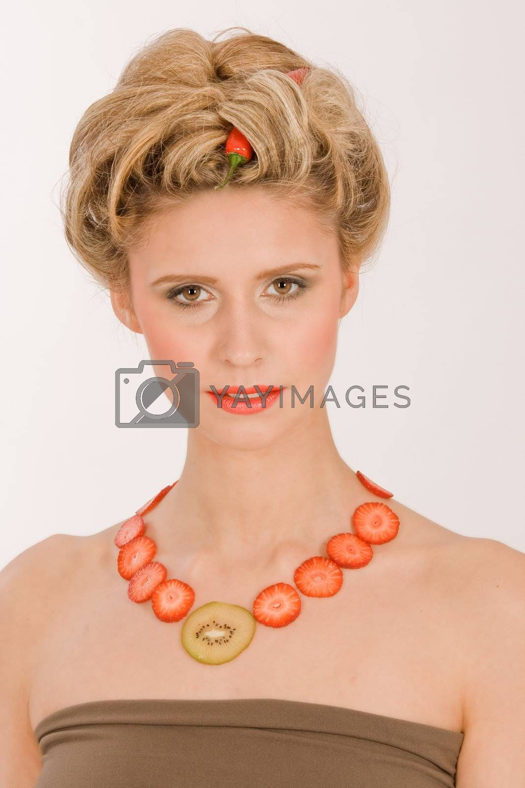 Young woman with a necklace made of strawberries and kiwi