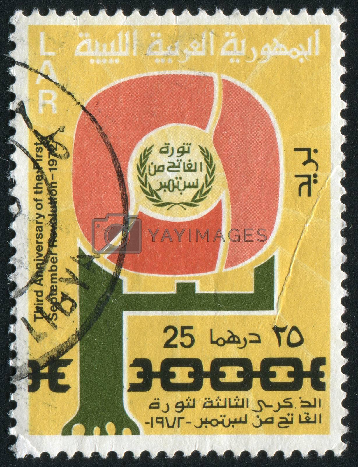 LIBYA  - CIRCA 1972: Emblem and Broken Chain, circa 1972.