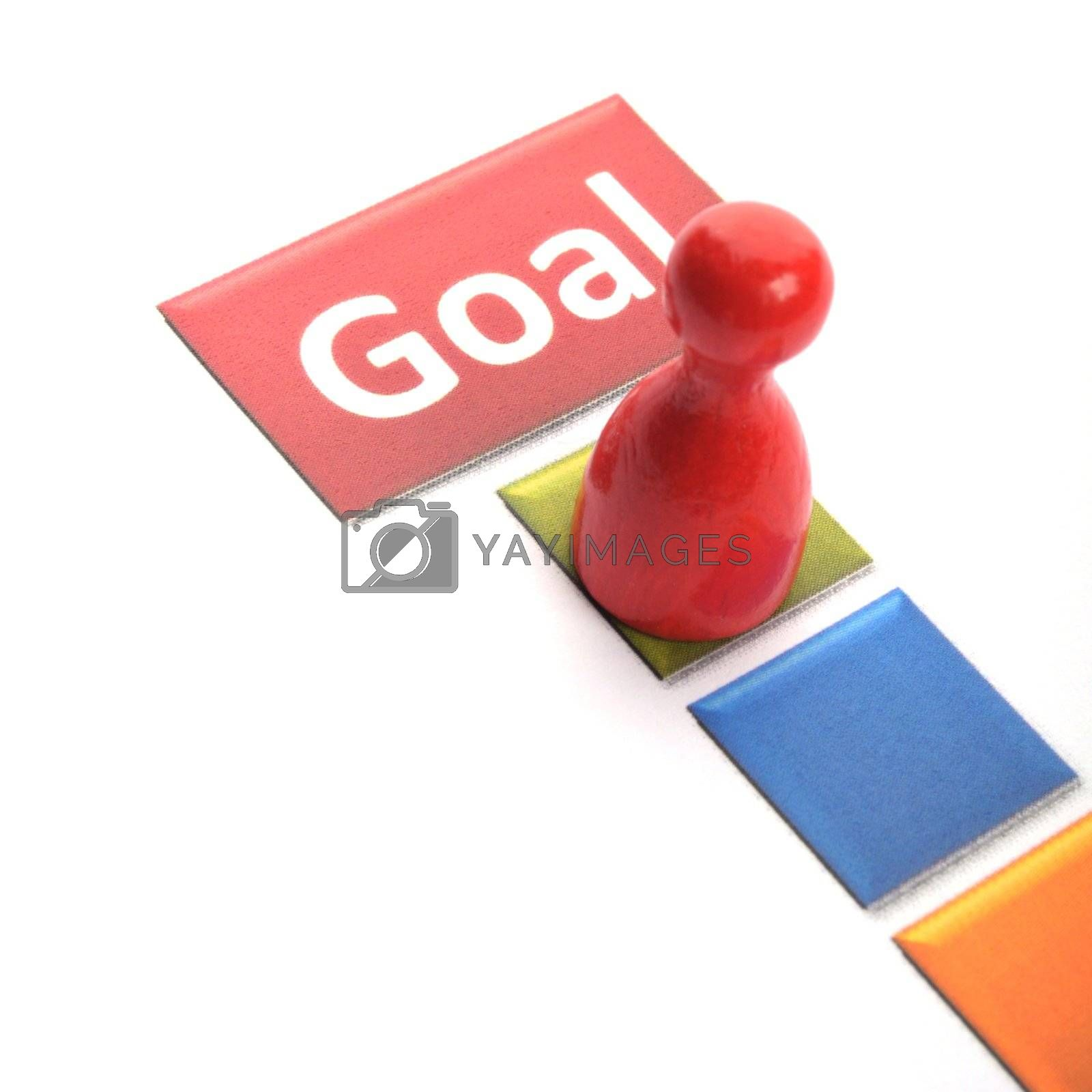 business goal concept with word and game pawn