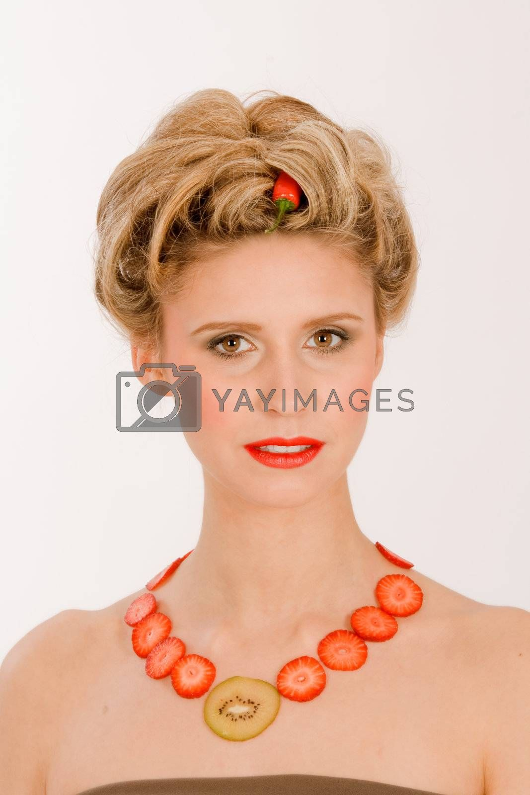 Attractive blonde woman with a chain around his neck from fruit