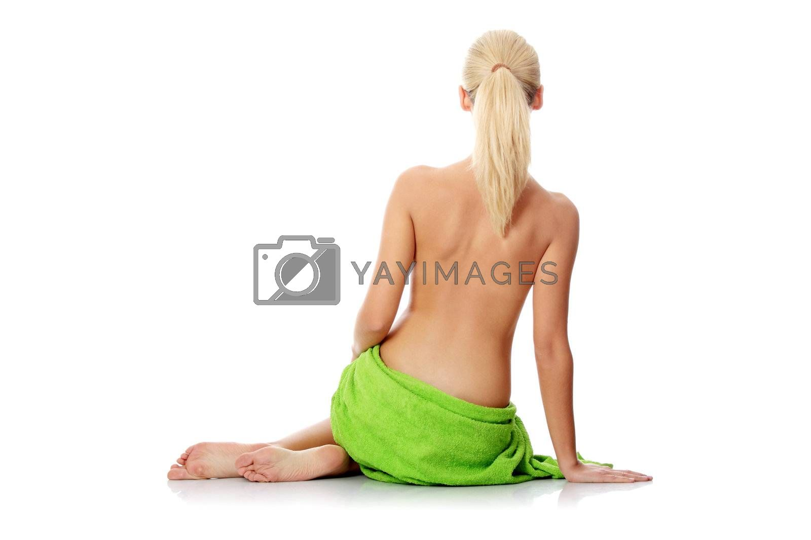 Young beautiful nude blond woman with towel , isolated on white