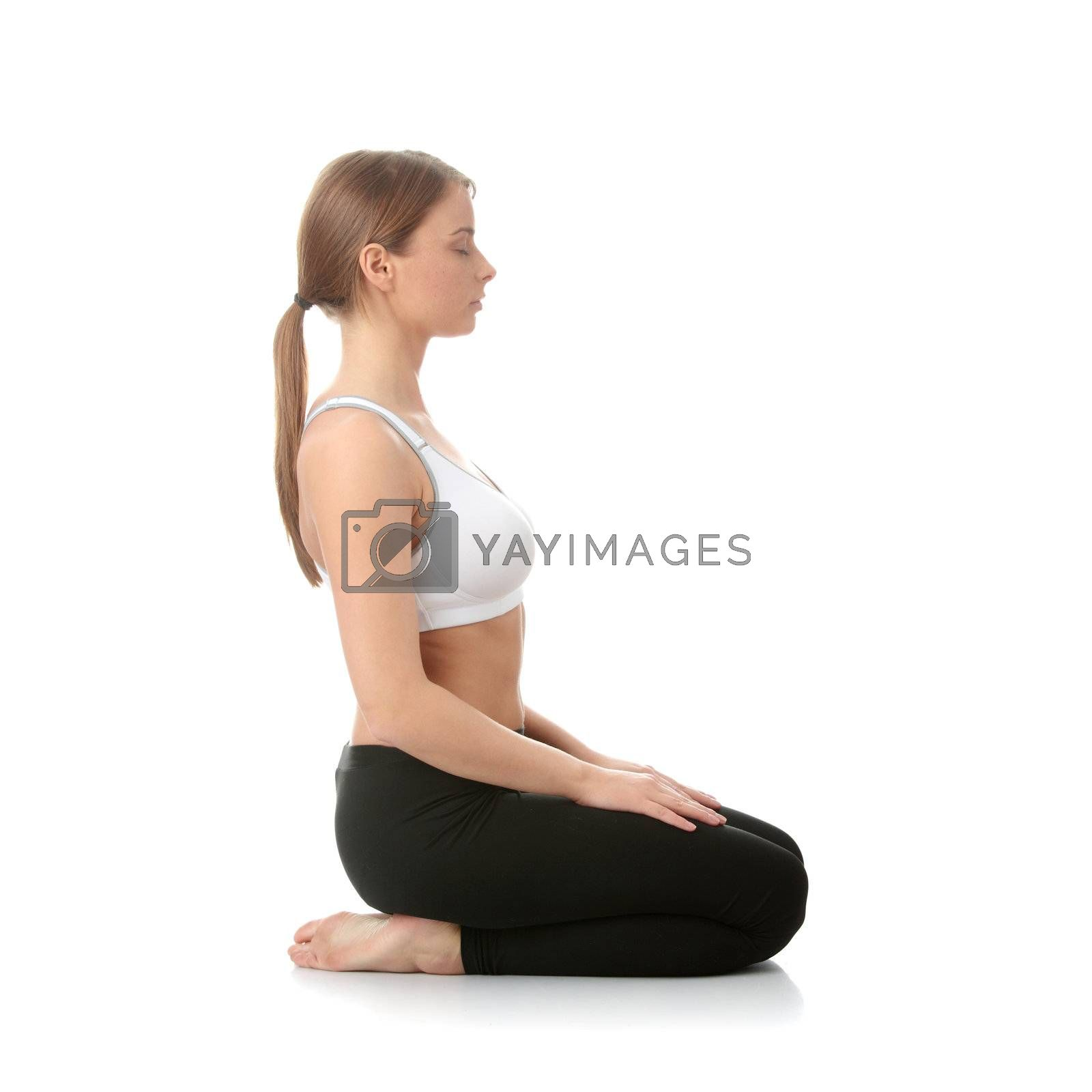 Beautiful young woman doing yoga exercise by BDS