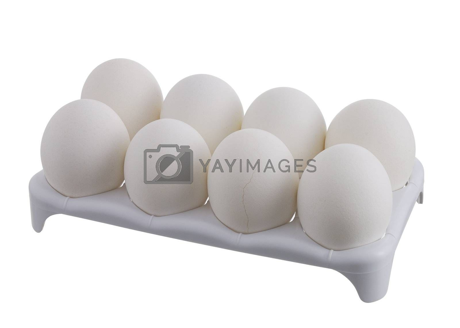 Eight white eggs with one cracked in white carton isolated on white background